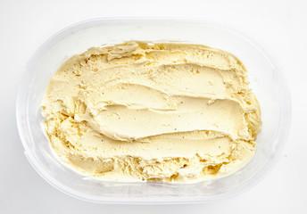 Top view of vanilla ice cream in plastic box