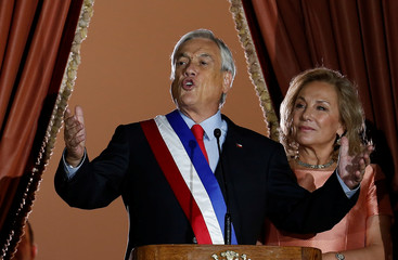 Chile's  President Sebastian Pinera accompanied by his wife, first lady Cecilia Morel speaks at La Moneda Presidential Palace in Santiago