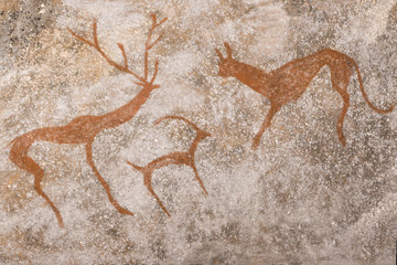 An image of ancient animals on the wall of the cave. stone Age. history. archeology.