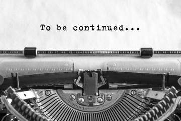 To be continued... typed words on a old Vintage Typewriter. Close-up.