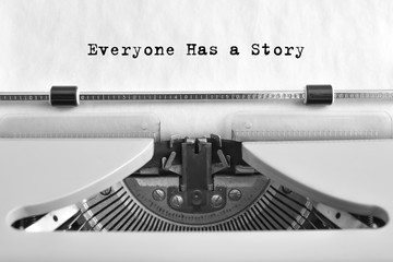 Everyone Has a Story, text typed on a vintage typewriter, close-up
