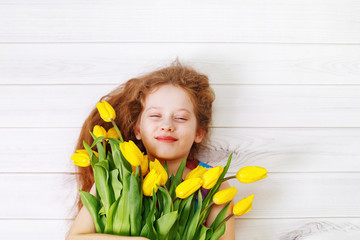 Little girl with bouquet of tulips.