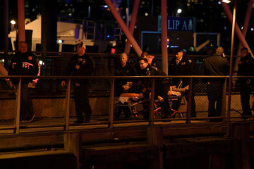 Paramedics perform CPR on a victim of a helicopter that crashed into the East River in New York