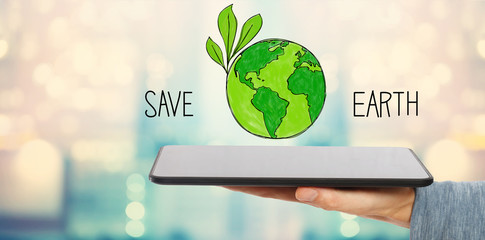 Save Earth with man holding a tablet computer