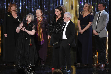 Director Aisling Walsh holds the award for best feature film during the Canadian Screen Awards in Toronto