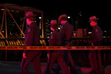 New York State Police are seen near East 34th Street/Midtown East Landing after a chartered Liberty Helicopters helicopter crashed into the East River in New York