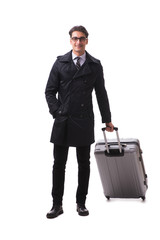 Young businessman with suitcase ready for business trip on white