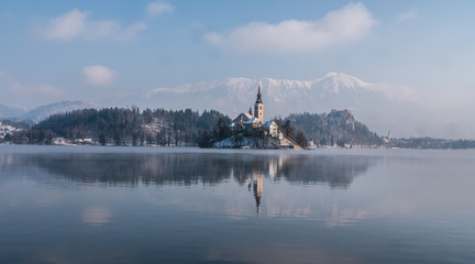 Beautiful Bled lake landmark with church on the island at sunrise