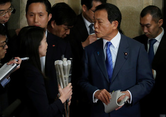 Japan's DPM and Finance Minister Aso speaks to reporters at the Finance Ministry in Tokyo