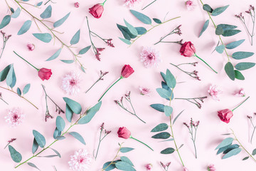 Flowers composition. Pattern made of pink flowers and eucalyptus branches on pink background. Flat lay, top view