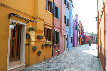 Venice, Burano island, Italy - typical street with colorful houses