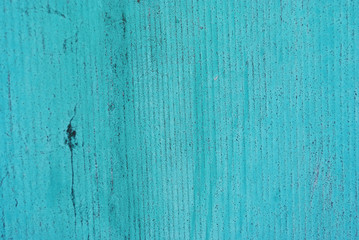 Wooden old surface painted with turquoise shabby paint, grunge background texture