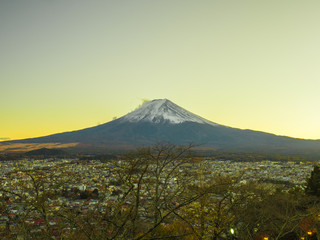 Fuji mountain with golden sky in twilight time.