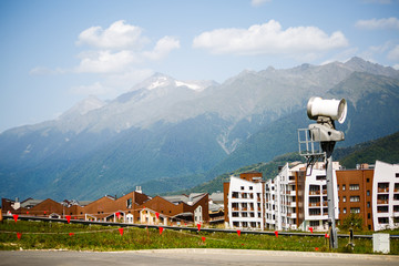 Photos of buildings at foot of mountains