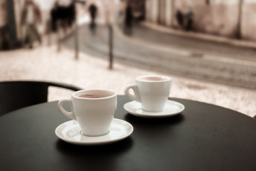 Coffee cup on table in cafe.