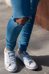 legs of young woman with jeans shorts and cuts