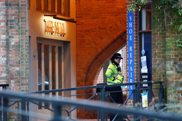 A police officer stands on duty outside a pub which has been secured as part of the investigation into the poisoning of former Russian intelligence agent Sergei Skripal and his daughter Yulia