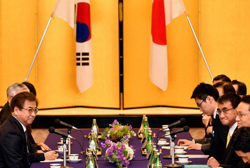 South Korea's National Intelligence Service chief Suh Hoon meets Japan's Foreign Minister Taro Kono