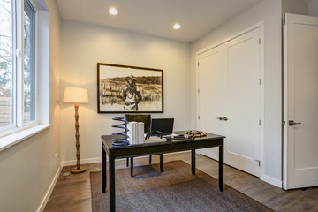 Modern home office design with black wood table
