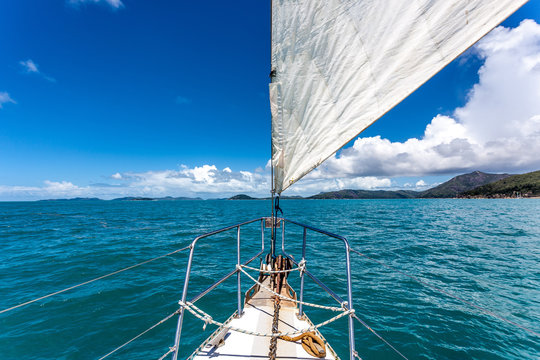 Sail boat on open water around the whitsunday islands in Australia