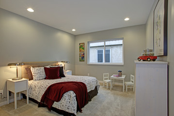 Fun kids bedroom design with soft blue walls