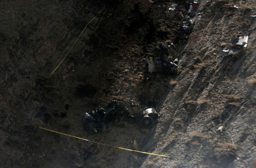 View shows the site of a crashed plane owned by the private holding company of Turkish businessman Huseyin Basaran