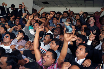 Supporters of Bangladesh Nationalist Party (BNP) shout slogans as they celebrate the bail of Khaleda Zia in Dhaka