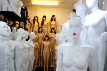 Mannequins are displayed for sale at a shop in Hanoi, Vietnam
