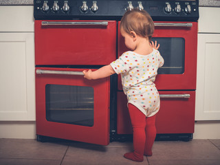 Little boy opening the oven