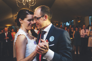 Newlywed couple dancing on their wedding day