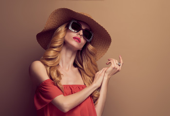 Fashion Art Studio Portrait Glamour Beautiful Blond Lady. Fashionable Hairstyle, Luxury Trendy Sunglasses. Sensual Woman in Summer Stylish fashion Hat. Young Playful female model, Vintage