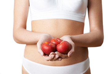 Close Up Of Woman In Underwear Holding Fresh Plums