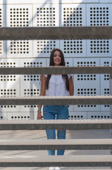 young woman smiling on some metal stairs