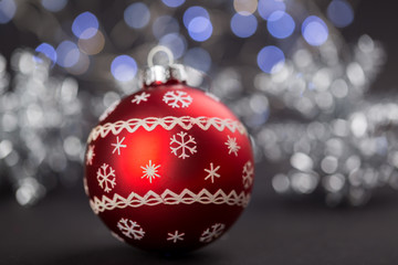 Close Up Still Life of Red Christmas Ball Decorations with Variety of Painted Patterns and Finishes on Dark Gray Background with Copy Space