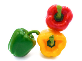 Fresh vegetables, red, yellow, green sweet peppers on white background.