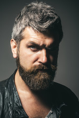 Fashion for men. Seasonal fashion. Portrait of cool seductive sexy unshaven man in black leather jacket. Serious bearded man in leather jacket with stylish hairdo. Fashion look, trendy man. Closeup.