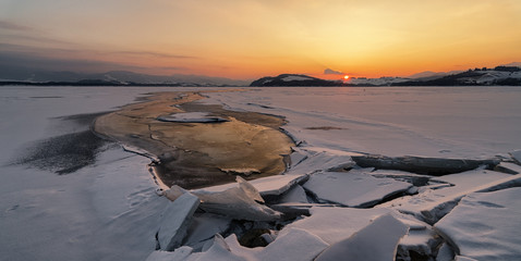 Colorful twilight over frozen lake