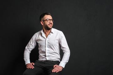 Businessman isolated over dark black background