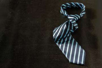 tie on dark background