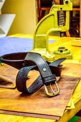 leather workshop belt in front of grips on table