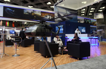 model of a helicopter is on display during Doha International Maritime Defence Exhibition, in Doha