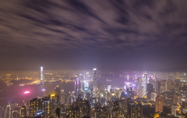 Panoramic Aerial View of Illuminated Hong Kong Skyline and Victoria Harbour at Night. Long Exposure