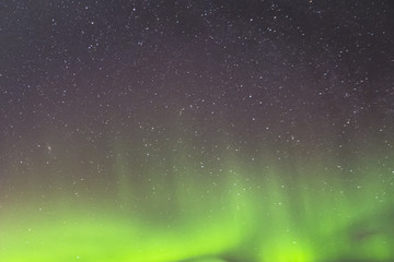 Starry Sky at Night and Green Northern Lights. Abstract Background