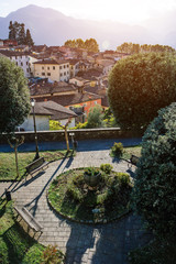 Scenic townscape of ancient medieval italian city Barga, Tuscany, Italy. Beautiful vertical travel destination postcard.