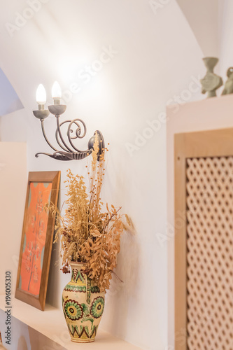 Room Decoration Elements   Clay Vase With Dry Flowers And Forged Wall Brace