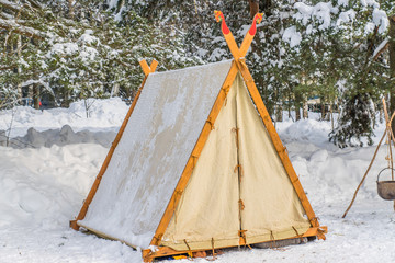 tent wigwam in winter forest