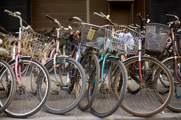 Bicycles at a parking zone in downtown Shanghai, China, Asia