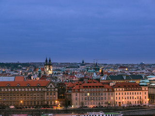 Poster Prague Scenic view of Historical center of Prague during blue hour after sunset, buildings and landmarks of old Prague town,Czech Republic.