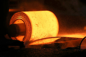 A steel coil is unrolled on the line at the Novolipetsk Steel PAO steel mill in Farrell, Pennsylvania