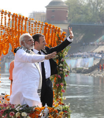 French President Emmanuel Macron and Indian Prime Minister Narendra Modi arrive by a boat to a ghat in Varanasi